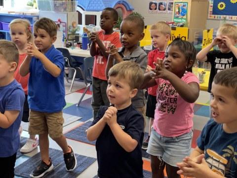 K4 students enjoy an action rhyme together.