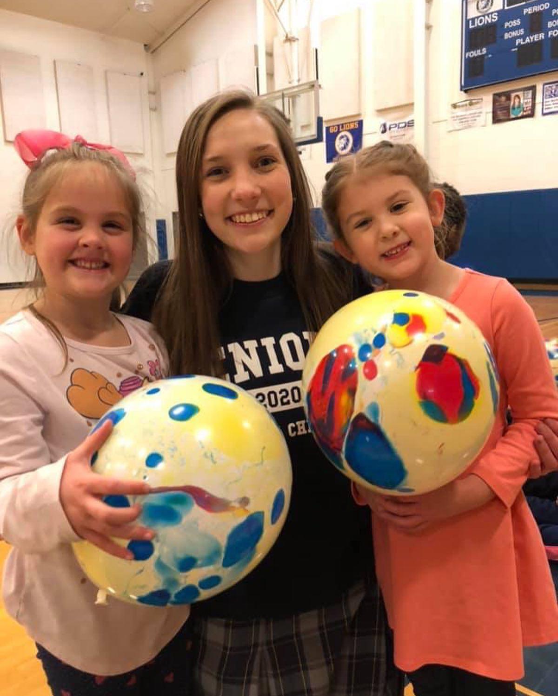 Preschool students love their high school mentors!