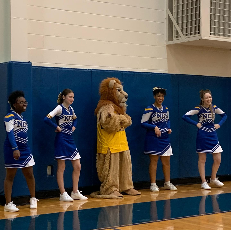 mascot and cheerleaders